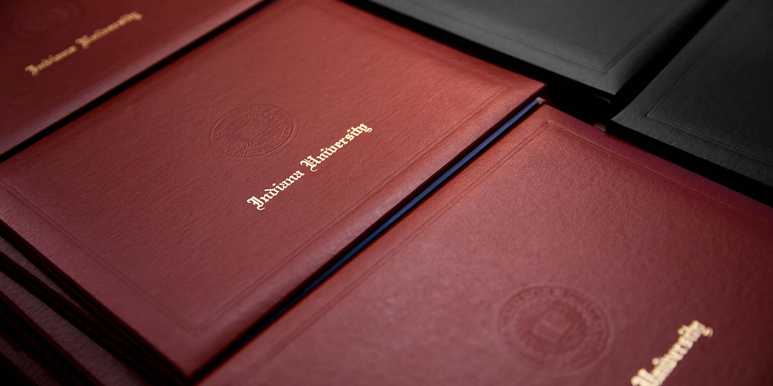 A close-up of diploma covers